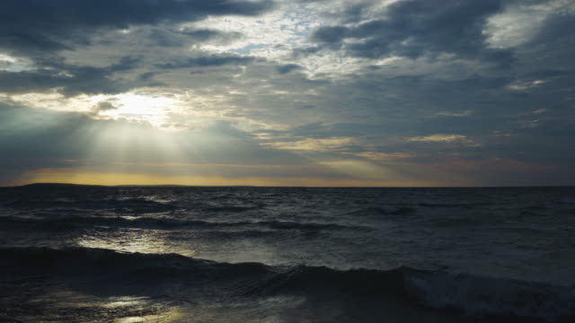 sunbeams over lake waves - michigan video stock e b–roll