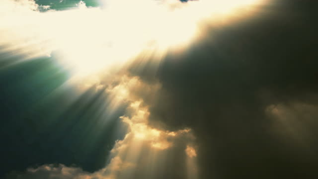 sunbeams shine through time lapse sunsetting clouds - heaven stock videos & royalty-free footage