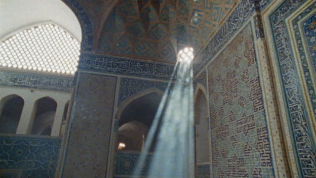 ws la pan sunbeams shining through windows in middle eastern mosque / iran - moschea video stock e b–roll