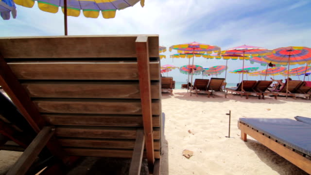 sunbeds and umbrella on the beach,dolly shot - armchair stock videos & royalty-free footage