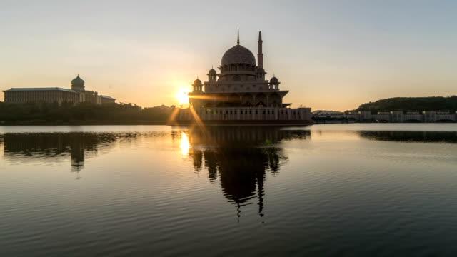 sunburst behind the mosque. time lapse. - putrajaya stock videos & royalty-free footage