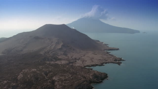 low aerial, sunda strait and krakatoa island, indonesia - indonesia volcano stock videos & royalty-free footage