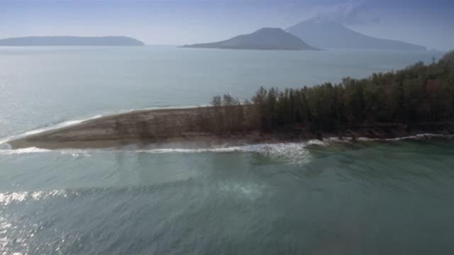 low aerial, sunda strait towards krakatoa island, indonesia - straits stock-videos und b-roll-filmmaterial