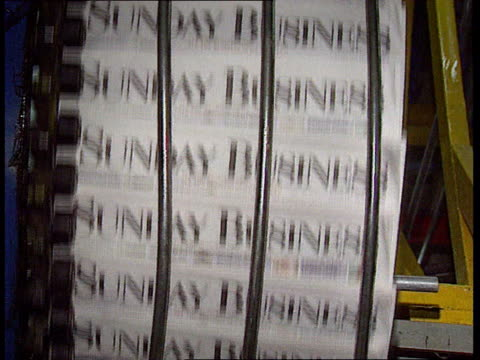 sunday business newspaper launched england london int template for new sunday newspaper 'sunday business' being fixed to roller on printing press... - poster template stock videos & royalty-free footage