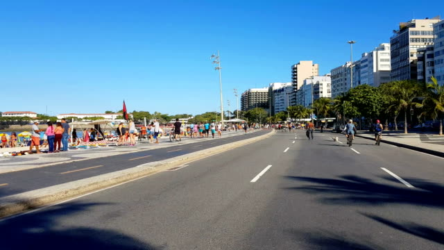 sunday in copacabana beach - avenue stock videos & royalty-free footage