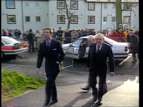 sunday mirror royal divorce story; tx 9.12.92 htv ext wales: anglesey prince charles towards with two other men r-l as past) - divorce stock videos & royalty-free footage