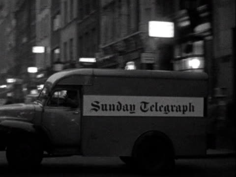 a sunday telegraph delivery van leaves the telegraph offices in fleet street - telegraph machine stock videos & royalty-free footage