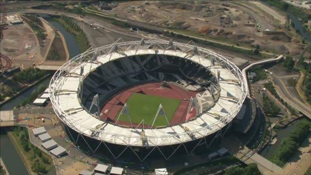 'sunday times' report on top athletes suspicious drugs tests date london stratford olympic park olympic stadium - itv weekend lunchtime news点の映像素材/bロール