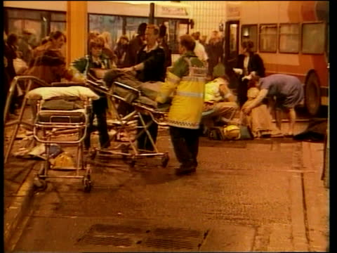 Sunderland INT Emergency services in bus station tending to people injured after bus ran out of control killing two woman Firemen around bus trying...
