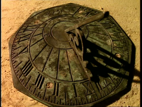 t/l sundial, with stone background, shadow moves around timepiece - instrument of time stock videos & royalty-free footage