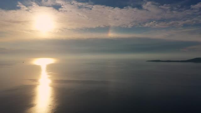 sundog over the aegean islands near methana, greece - sundog stock videos & royalty-free footage