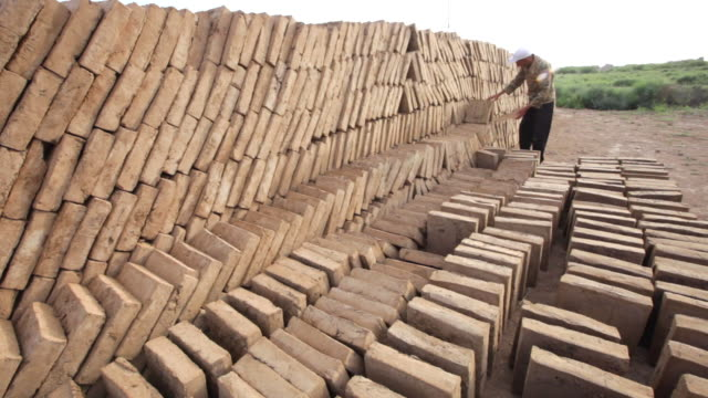 sun-dried mud bricks are produced today in a special workshop in merv; they are used for restoration and preservation purposes in merv archaeological complex - mud stock videos & royalty-free footage