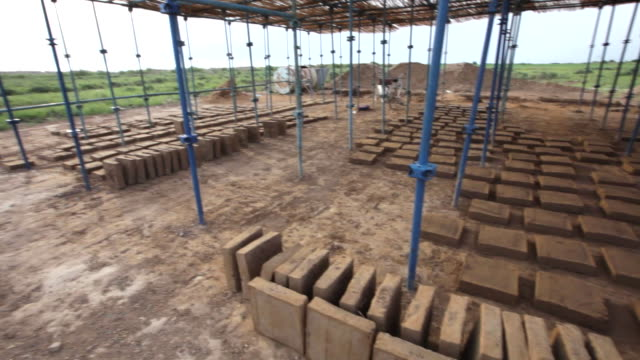 sun-dried mud bricks are produced today in a special workshop in merv; they are used for restoration and preservation purposes in merv archaeological complex - brick stock videos & royalty-free footage