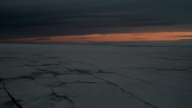 ws pan sunet over cracking ice sheets - antarctica sunset stock videos & royalty-free footage