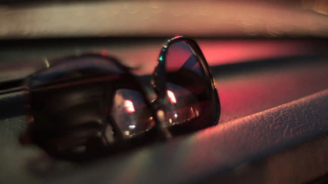 Sunglasses on Dashboard - Slow Motion