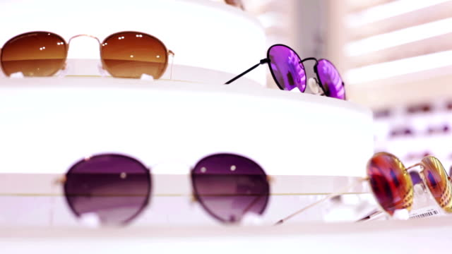 sunglasses store - tradeshow stock videos & royalty-free footage