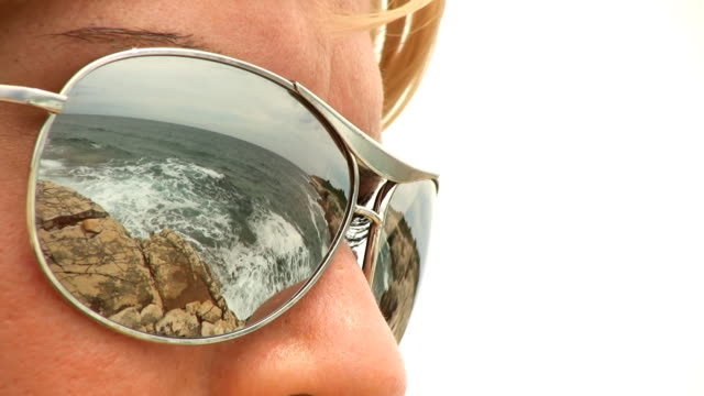 HD: Sunglasses With Reflection Of Beach Scene