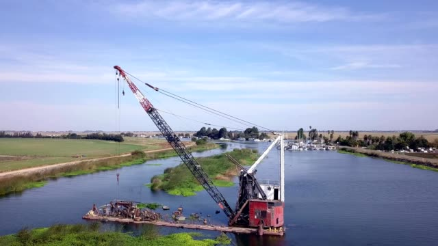 a sunken crane on a barge - backwater stock videos & royalty-free footage