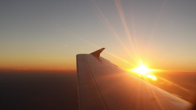 sunlight airplane wing - business travel stock videos & royalty-free footage