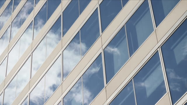 sunlight and clouds reflecting off office windows - wall building feature stock videos & royalty-free footage