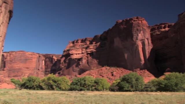 WS Sunlight and shadow on rock walls with trees at bottom/ Canyon de Chelly National Monument, Arizona