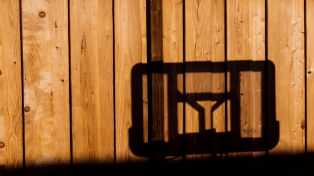 sunlight basket-support shades motion 4k dci - penombra video stock e b–roll