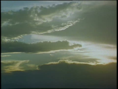 sunlight breaks through layers of stratus clouds. - stratus stock videos & royalty-free footage