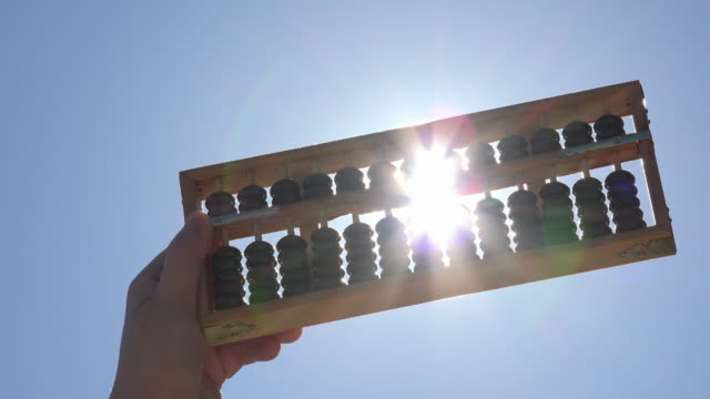 Sunlight bursts through the abacus