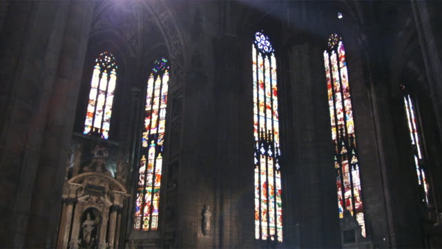 WS LA TU Sunlight coming through stained glass windows in church / Milan, Italy