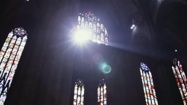WS LA PAN Sunlight coming through stained glass windows in church / Milan, Italy