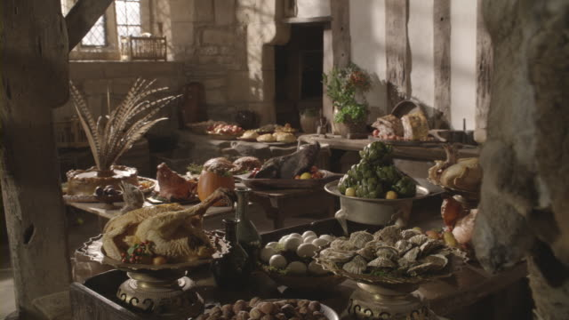 Sunlight from a window illuminates a festive feast on a table.