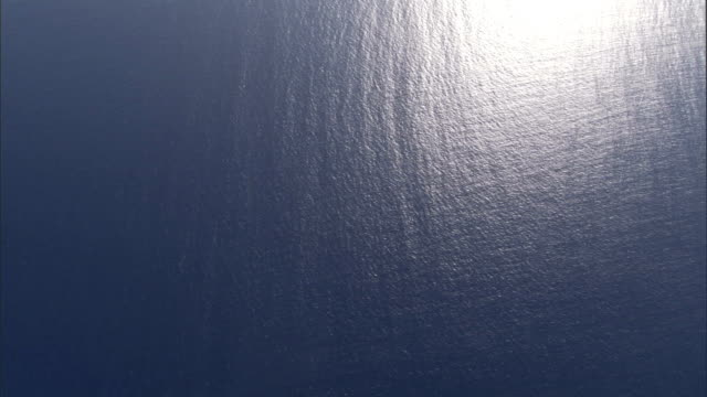 Sunlight glares off the surface of the Mediterranean Sea. Available in HD.