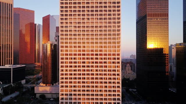 sunlight glinting on la skyscrapers - office block exterior stock videos & royalty-free footage