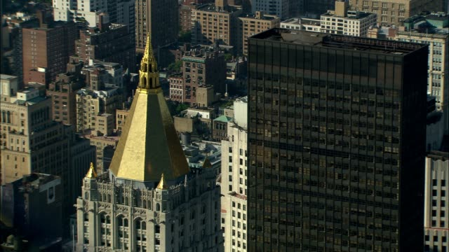 sunlight glints off a gold spire in new york city. - spire stock videos & royalty-free footage