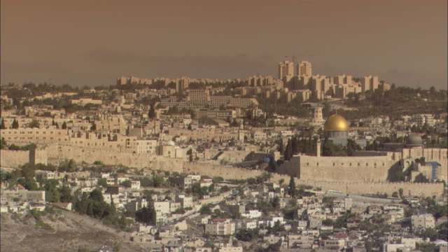 sunlight glints off the dome of the rock in jerusalem. - jerusalem stock videos and b-roll footage