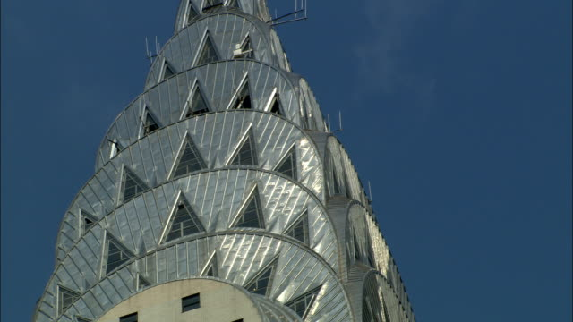sunlight glints off the metallic crown of the chrysler building. - chrysler building stock videos & royalty-free footage