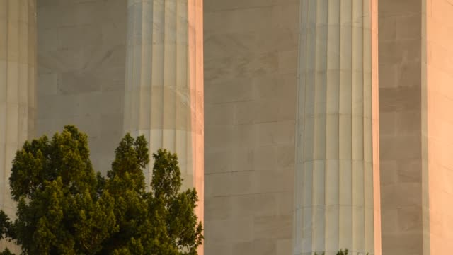sunlight illuminates doric columns and a facade of the lincoln memorial early in the day. - doric stock videos & royalty-free footage
