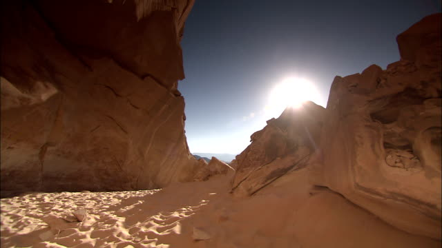 sunlight illuminates sand in a gilf kebir crevice. - crevice stock videos & royalty-free footage