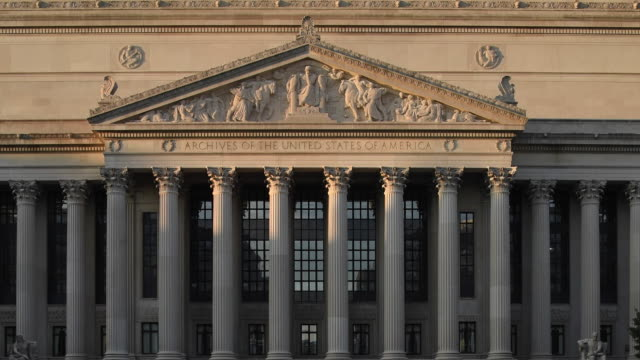 stockvideo's en b-roll-footage met sunlight illuminates the entrance facade of the national archives building in washington, dc. - national archives washington dc