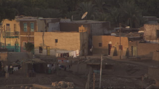 sunlight illuminates the sides of residential buildings. - slum stock videos & royalty-free footage