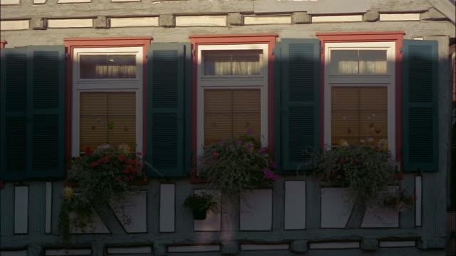 Sunlight illuminates the windows of a house.
