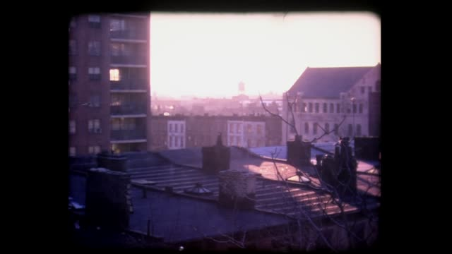 1973 sunlight moving across brooklyn roof tops - home movie stock videos & royalty-free footage