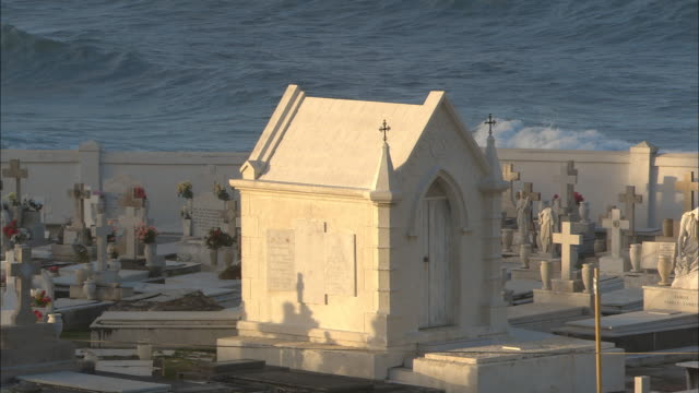 ms sunlight on crypt in cemetery next to el morro fort with atlantic waves in background/ old san juan, puerto rico - crypt stock videos and b-roll footage