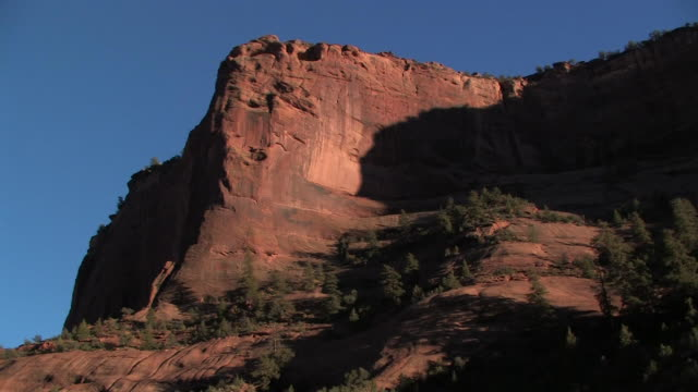 la ms sunlight on rock wall with trees at bottom/ canyon de chelly national monument, arizona - canyon de chelly stock videos & royalty-free footage