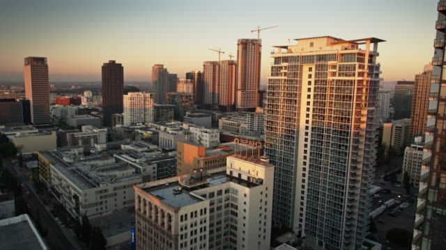 sunlight on south park, downtown los angeles - aerial shot - modern art stock videos & royalty-free footage