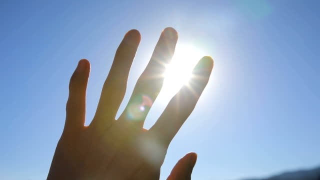 sunlight passing through fingers - hope stock videos & royalty-free footage