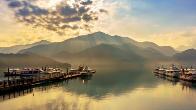 sunlight rays of sun moon lake, nantou, taiwan - taiwan stock videos and b-roll footage