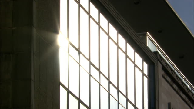 sunlight reflected in building window, bristol, uk - sunbeam stock videos & royalty-free footage