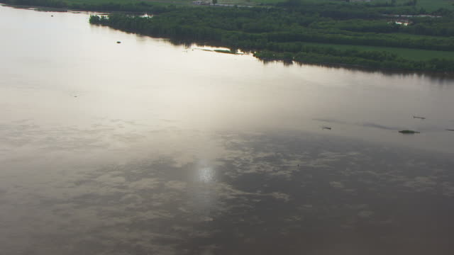 WS PAN AERIAL POV Sunlight reflected in Mississippi river / Iowa, United States