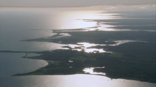 aerial sunlight reflecting in water along coastline / new bedford, massachusetts, united states - new bedford stock videos & royalty-free footage
